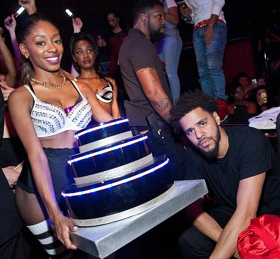 J. Cole poses with his birthday cake at Drai's Nightclub