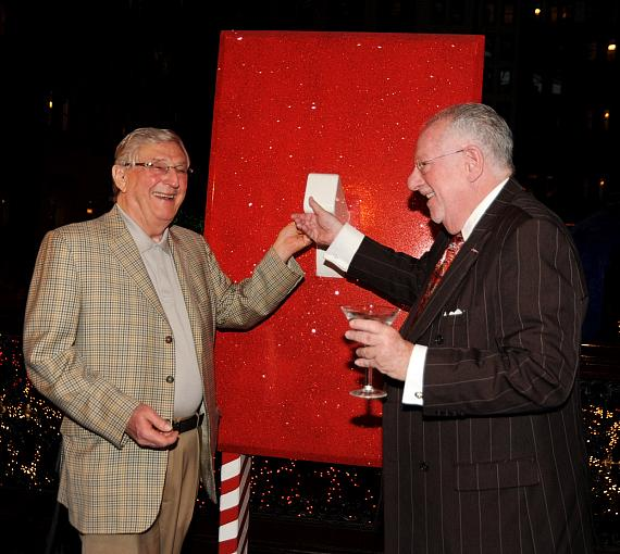 Boyd Gaming Executive Chairman Bill Boyd and LVCVA Host Committee Chairman Oscar B. Goodman flip the switch on the first run of the holiday show at Sam's Town Hotel and Gambling Hall's Mystic Falls Park Holiday Tree-Lighting ceremony