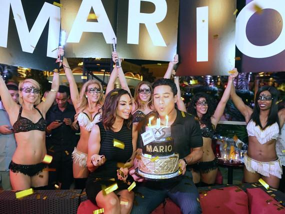 Mario Lopez blows out the candels on his birthday cake at XS Nightclub