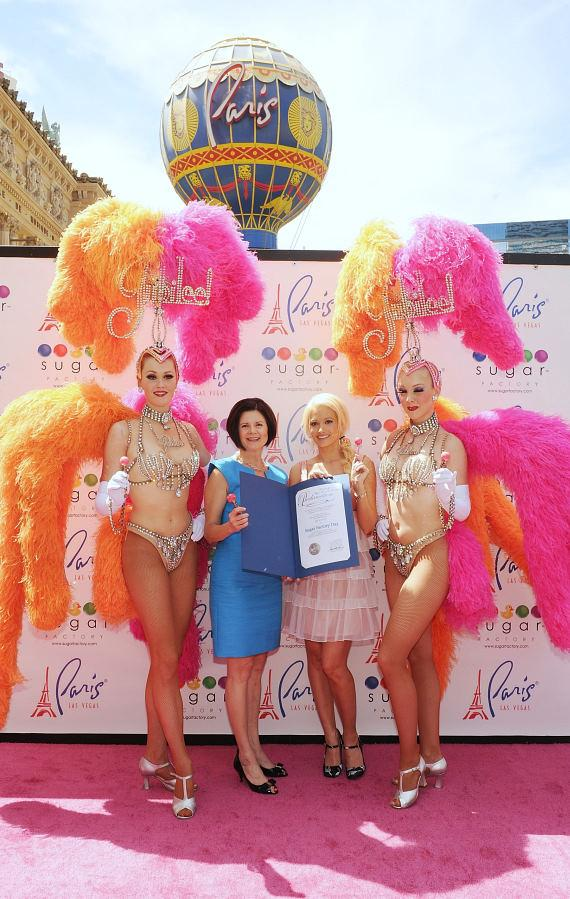 """Holly Madison with Jubilee showgirls and """"Sugar Factory Day"""" plaque"""