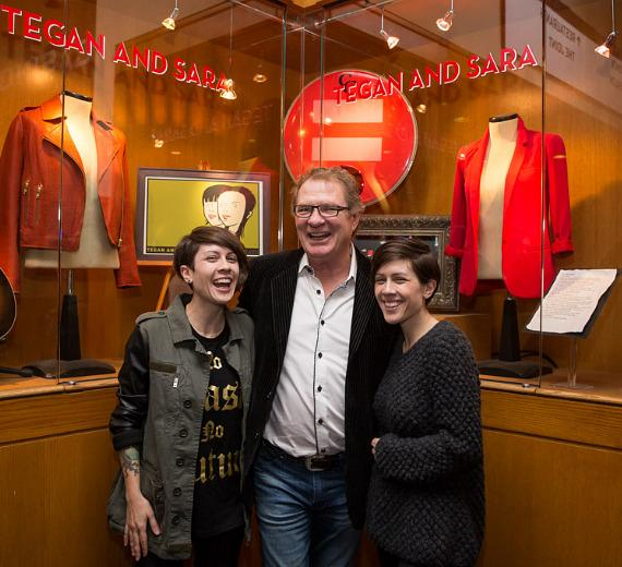 Rock duo Tegan and Sara with curator Warwick Stone pose at new Memorabilia Showcase in Hard Rock Hotel Las Vegas
