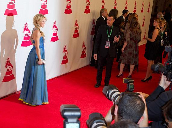 Shakira with photographers on red carpet at Latin Grammy Awards