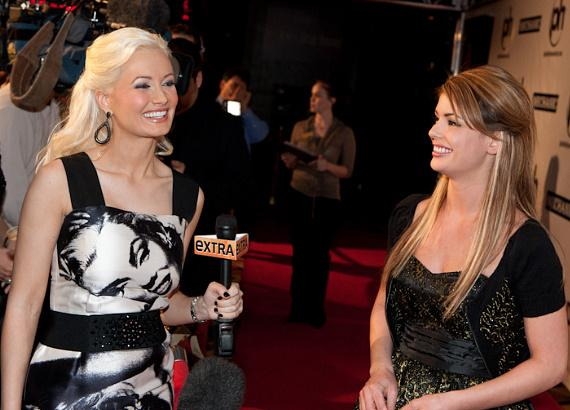 Holly makes her TV debut as EXTRA correspondent at Planet Hollywood