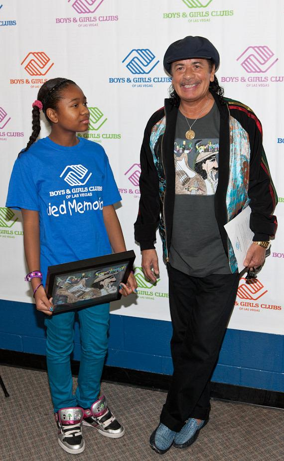 Carlos Santana with Imani, winning t-shirt designer from Lied Memorial Clubhouse