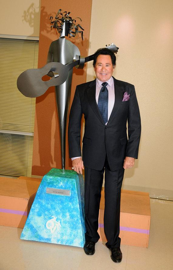 Wayne Newton with sculpture in his name at Opportunity Village