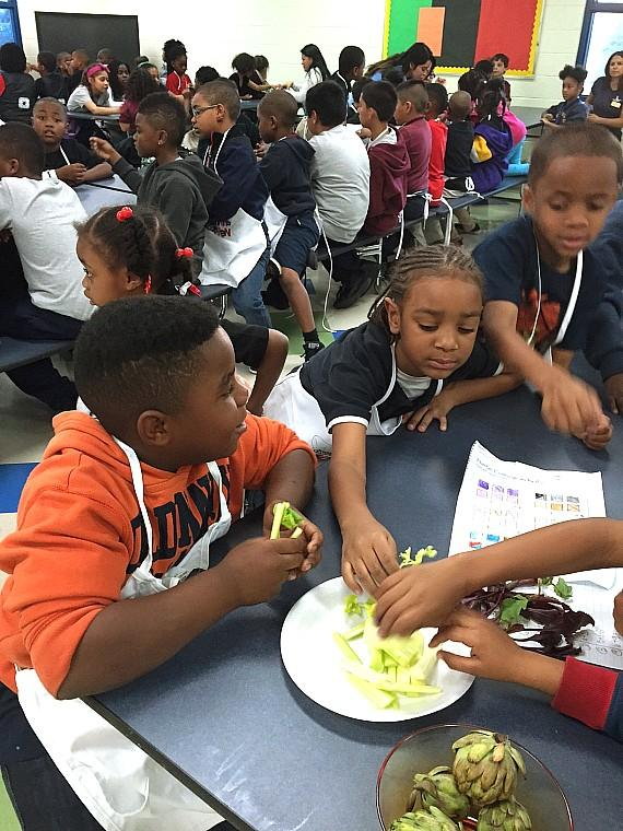 Boys and girls learn about new unique vegetables and herbs