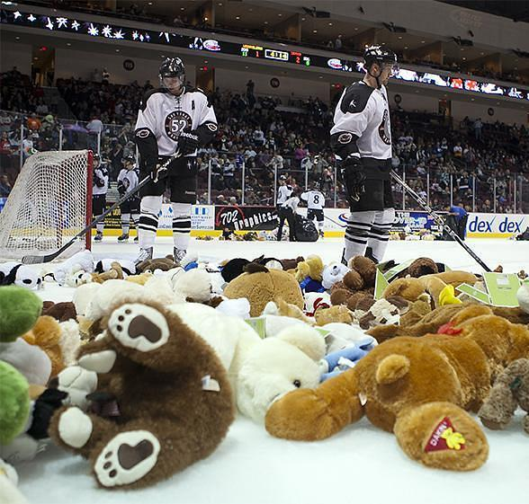 Wranglers players share the ice with stuffed animals during last season's Teddy Bear Toss
