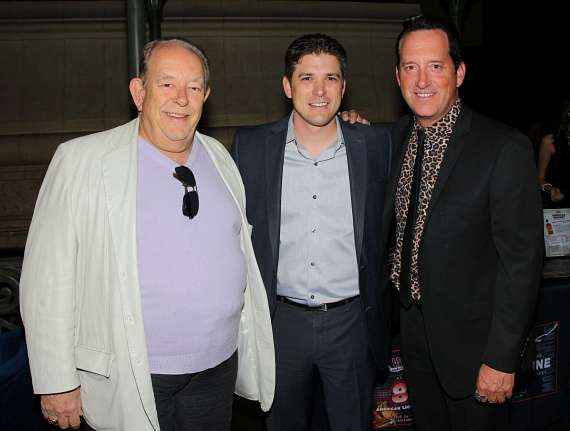 Robin Leach, a guest and Anthony Cools