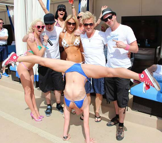 Chloe Crawford and guests watch dancer at Sapphire Pool & Dayclub
