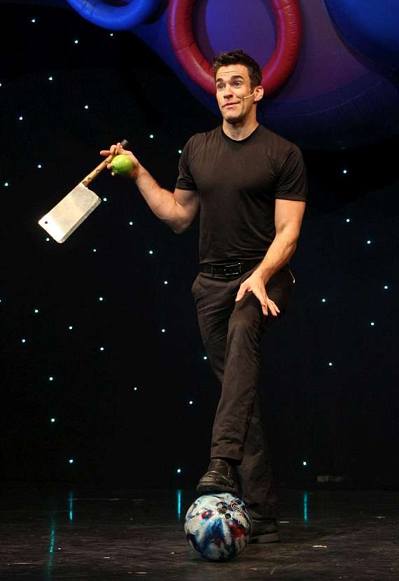Jeff Civillico juggles a cleaver, an apple and a bowling ballbalances a step ladder on his chin