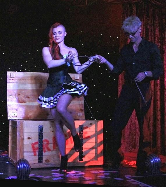 """April Leopardi Anneberg and Murray SawChuck perform in """"MURRAY 'Celebrity Magician'"""" at Planet Hollywood in Las Vegas"""