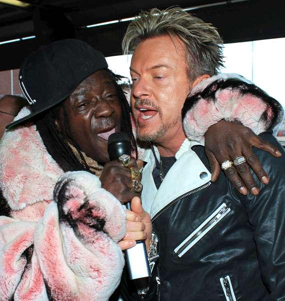 Flavor Flav and Zowie Bowie sing the National Anthem