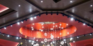 One-of-a-Kind Glass Dragon Chandelier Hung as the Centerpiece of Lucky Dragon Hotel & Casino
