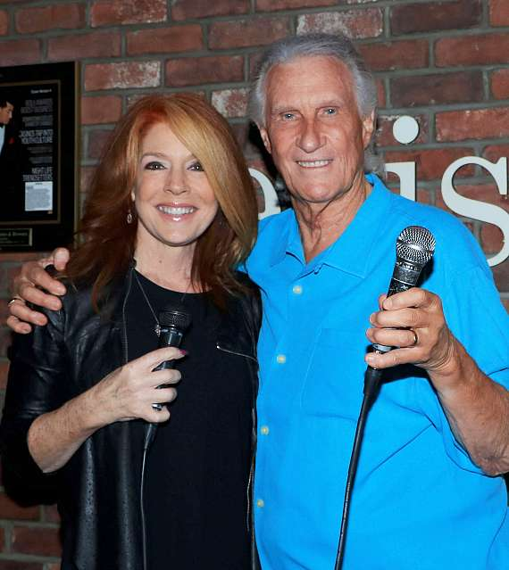 """Kelly Clinton-Holmes and Bill Medley at Ellis Island's """"Sing for Strength"""""""