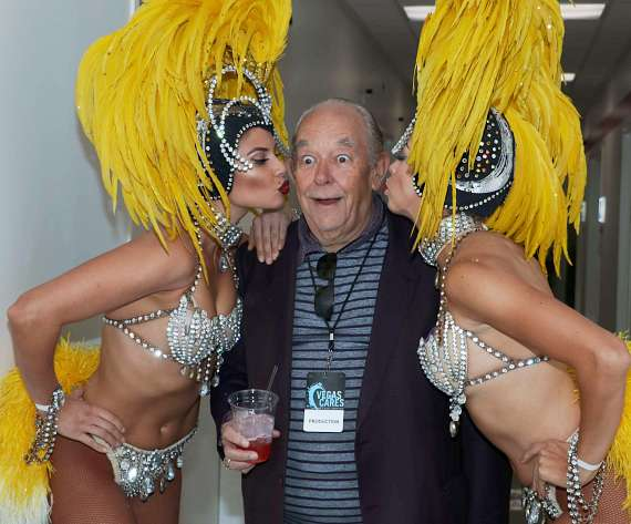 Robin Leach with Showgirls