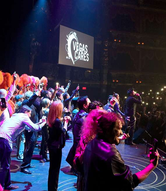 "Cast of ""Vegas Cares"" joins the band on stage"