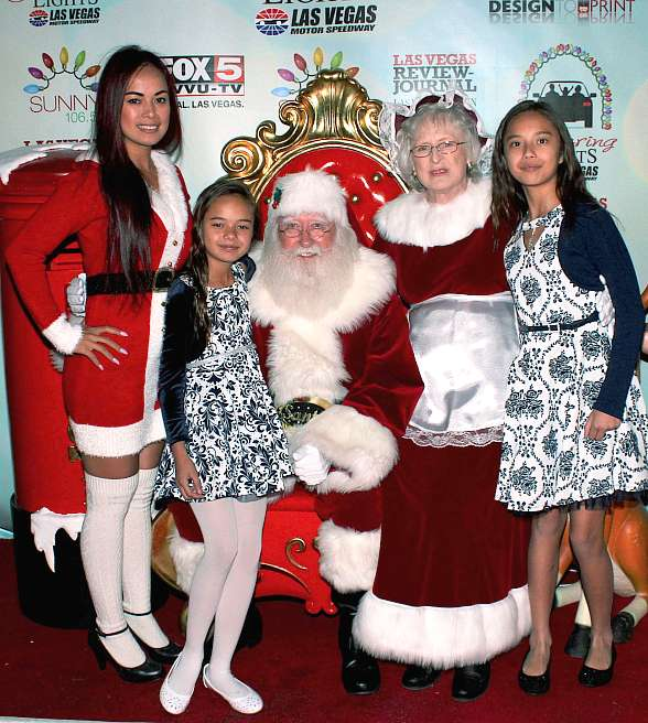Model Dancer Dixie Miranda with her daughters and Santa & Mrs. Claus