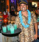 Golden-Tiki-General-Manager-Joey-DAmore-serves-tiki-punch-to-guests.–unsmushed