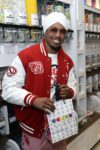 Nick-Cannon-in-candy-shop-with-Sugar-Factory-bag-credit_-Bryan-Steffy-unsmushed