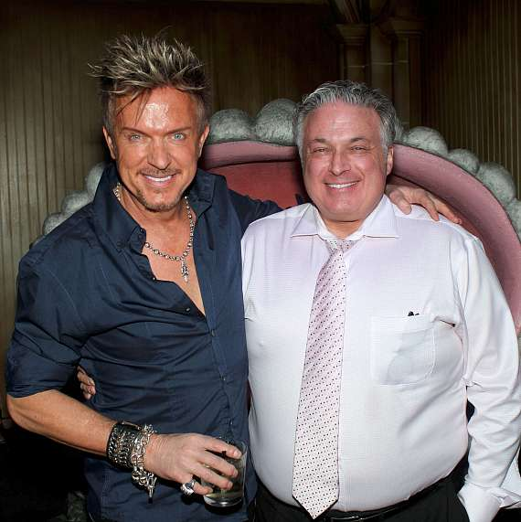 Chris Phillips of Zowie Bowie with Jeweler Michael Minden at The Golden Tiki in Las Vegas