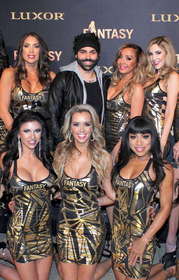 Stylist Joel Alvarez, creator of the calendar's gold tape concept, poses with cast of FANTASY