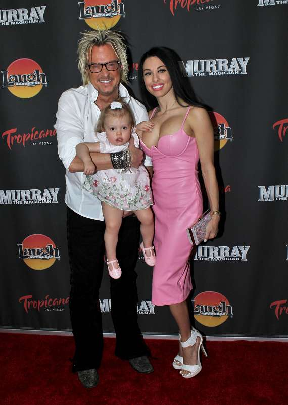 Chris Phillips of Zowie Bowie with wife Jennifer Lynne Phillips and their daughter