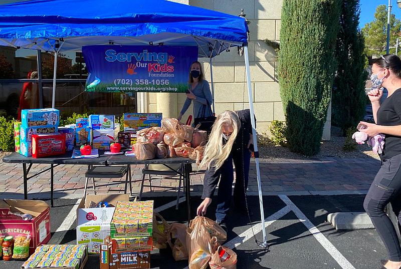 Santa Collects Food at Fort Apache Commons with Contactless Food Drive for Serving our Kids Foundation