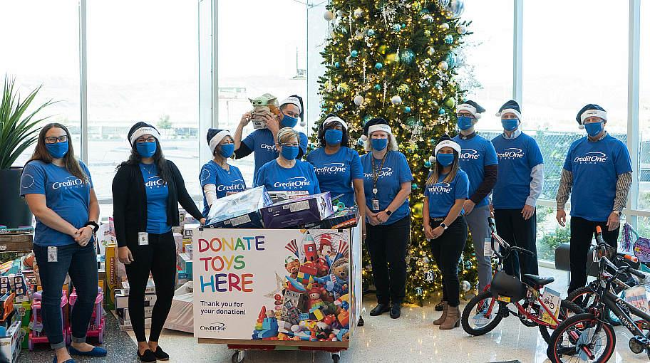 Credit One Bank Donates Bikes, Toys and Cash to the 98.5 KLUC Toy Drive to Benefit Help of Southern Nevada