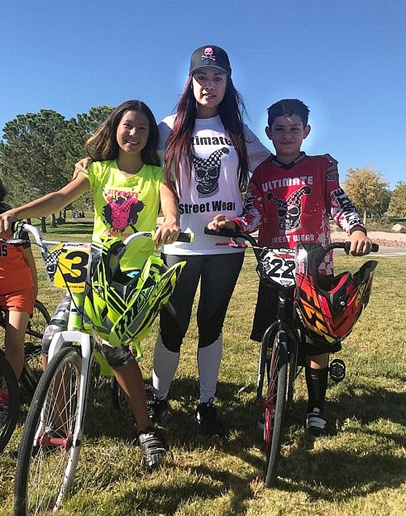 Dixie Miranda with kids and staff from Streetwear BMX Sports Team
