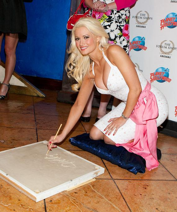 Holly Madison signs her name in the cement at Planet Hollywood