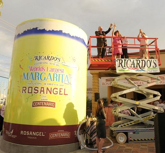 """Mayor Oscar B. Goodman and Congresswoman Shelley Berkley, pouring in the final ROSANGEL Tequila into the 14 foot tall, 10 foot wide tank to break the Guinness World Record at 7,627 gallons for the """"World's Largest Margarita""""."""