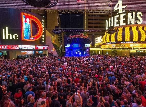 The crowd enjoys 3 Doors Down at the Fremont Street Experience outside the D Las Vegas