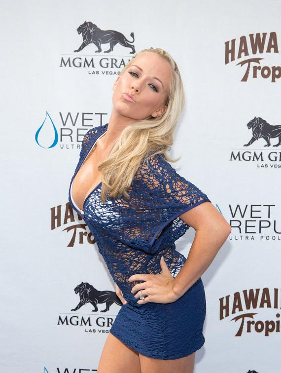 Kendra Wilkinson-Baskett poses for photographers on the blue carpet at WET REPUBLIC