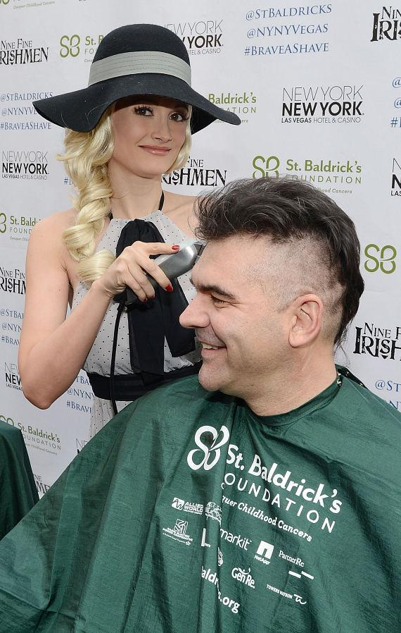 Holly Madison begins cutting the hair of John Katsilometes' at St. Baldrick's Day Fundraiser at New York - New York Hotel & Casino