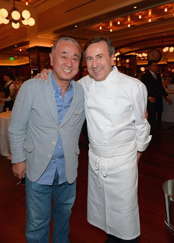 """Chef Daniel Boulud with his custom Welcome """"Back"""" to Las Vegas cake by Buddy """"The Cake Boss"""" Valastro, backed by showgirls of course!"""