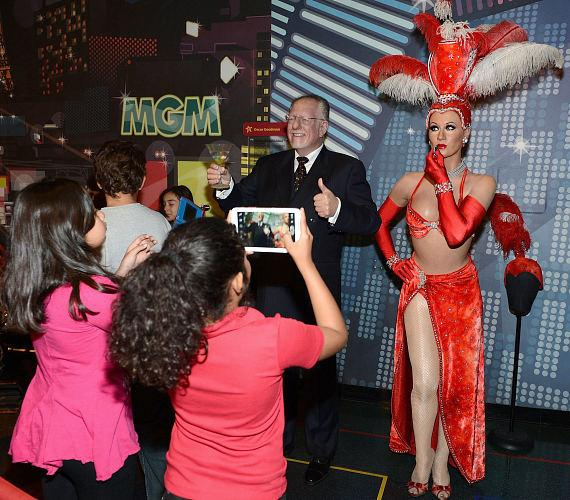 Childredn take photos with wax figures of former Mayor Oscar Goodman and a Las Vegas Showgirl at Madame Tussauds Las Vegas