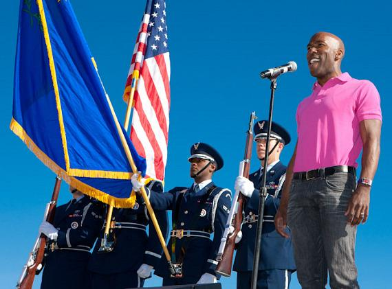 Eric Jordan Young, star of VEGAS! The Show sings the National Anthem
