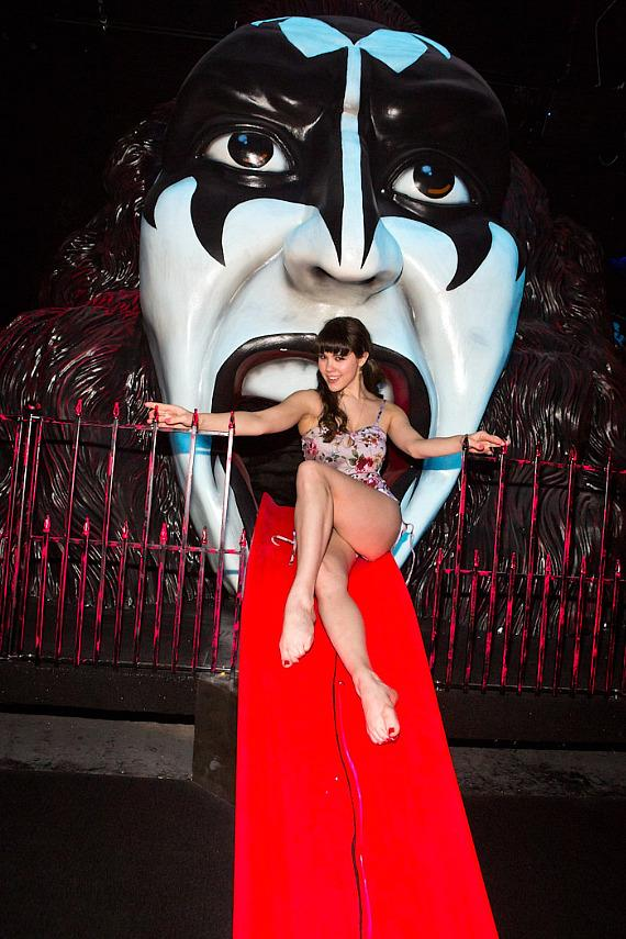 Claire Sinclair poses on Gene Simmons' tongue at KISS Monster Mini Golf in Las Vegas