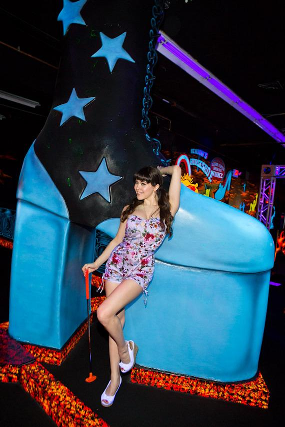 Claire Sinclair poses near giant KISS boot inside KISS Monster Mini Golf in Las Vegas