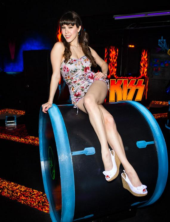 Claire Sinclair poses on KISS drum at KISS Monster Mini Golf in Las Vegas