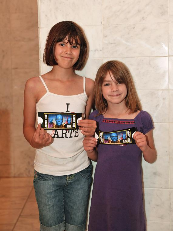 Kids show their tickets to Blue Man Group