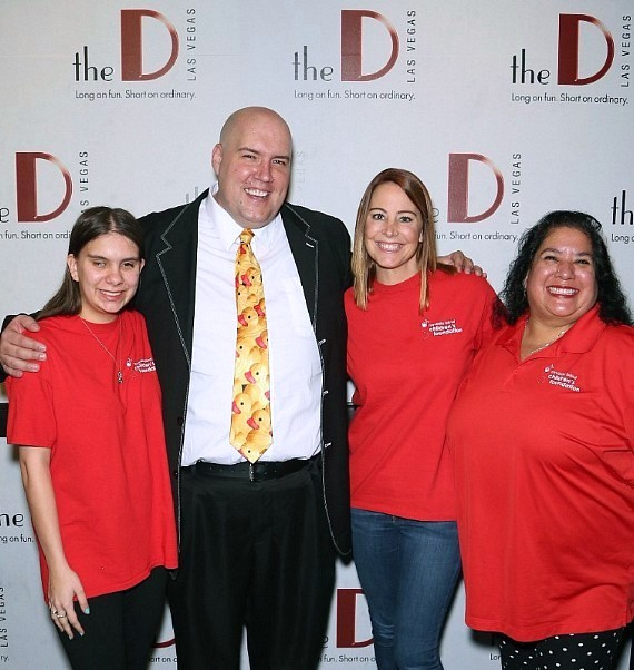 Adam London posing with representatives from Nevada Blind Children's Foundation. Left to right: Carly Lamb, Adam London, Leslie Jones and Robin Lamb