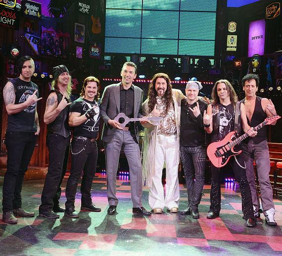 Actor Mark Shunock ( 3rd from L ), Vice President of food and beverage at the Venetian/Palazzo Sebastian Silvestri (4th from L ), ROCK OF AGES guest star Joey Fatone (4th from R ) and cast members of ROCK OF AGES during the key presentation to Bourbon Room at The Venetian Las Vegas