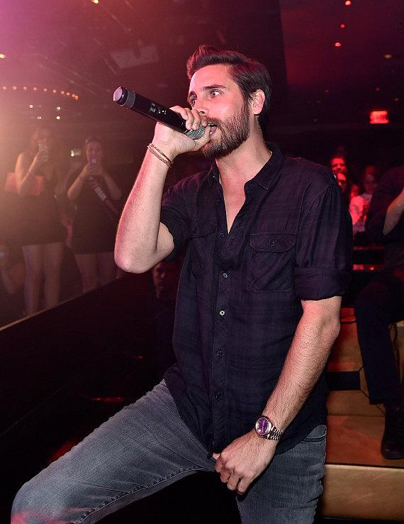 Scott Disick speaks on the microphone as he hosts at 1 OAK Nightclub at The Mirage Hotel & Casino