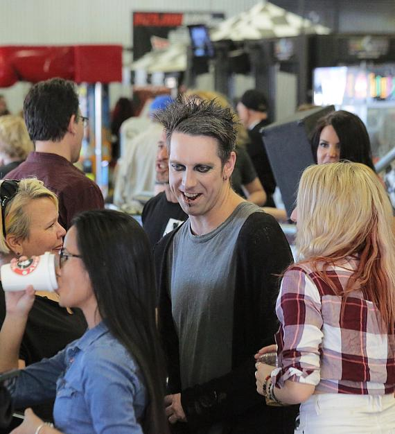 Mime/Magician Tape Face mingles with veterans and other guests at the Mike Hammer Celebrity Go-Kart Race