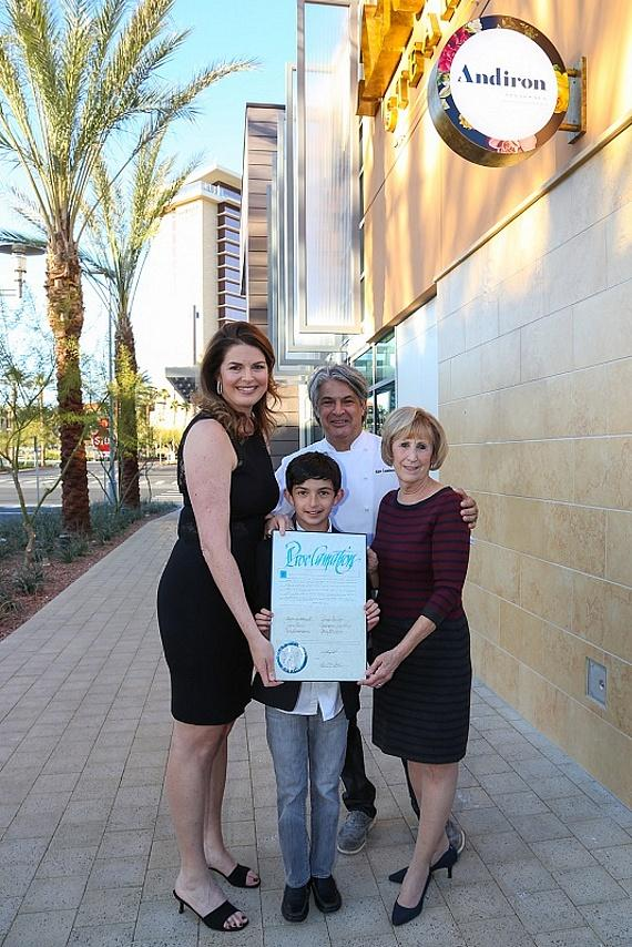 Elizabeth Blau, husband Chef Kim Canteenwalla and son Cole Canteenwalla receive a proclamation from Commissioner Susan Brager
