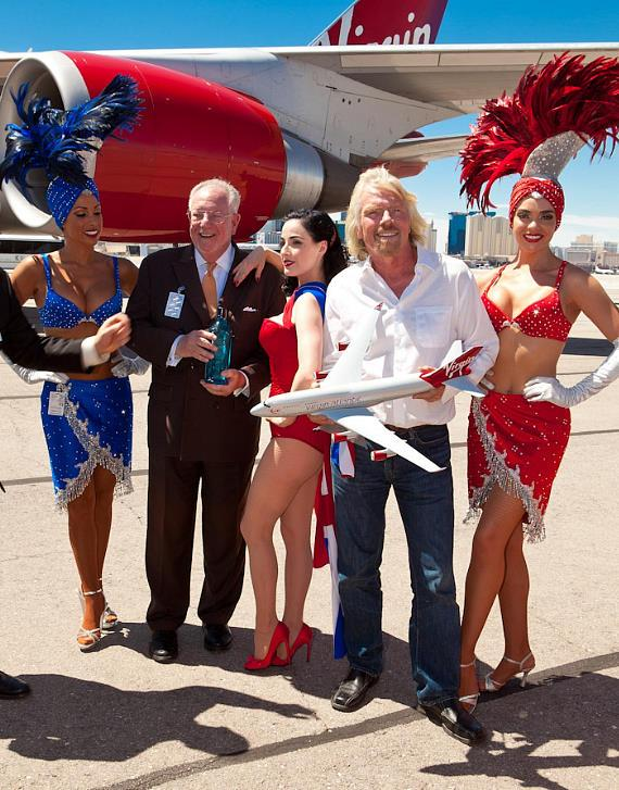 Sir Richard Branson and Dita Von Teese with Mayor Oscar Goodman and showgirls