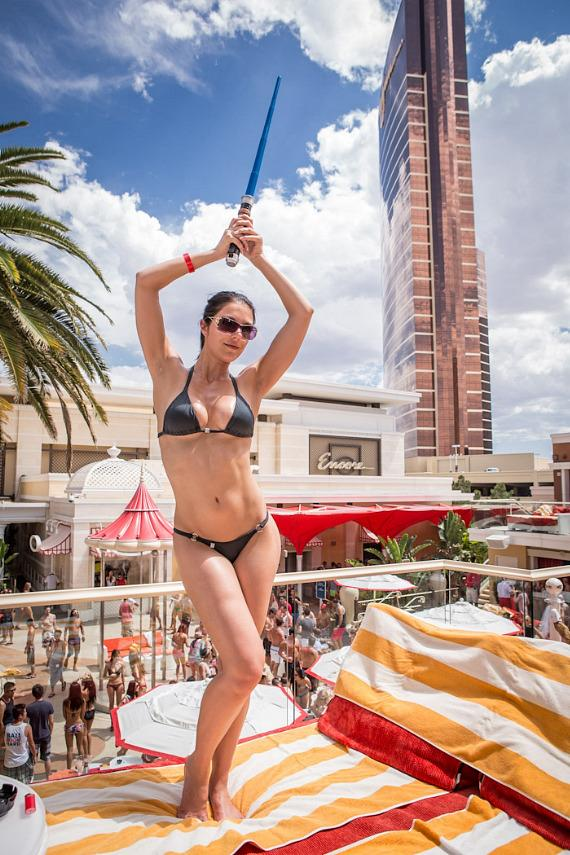 Curry plays with light saber at Encore Beach Club