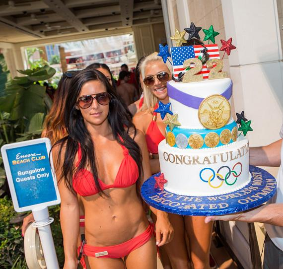 Micheal Phelps' retirement cake is presented at Encore Beach Club