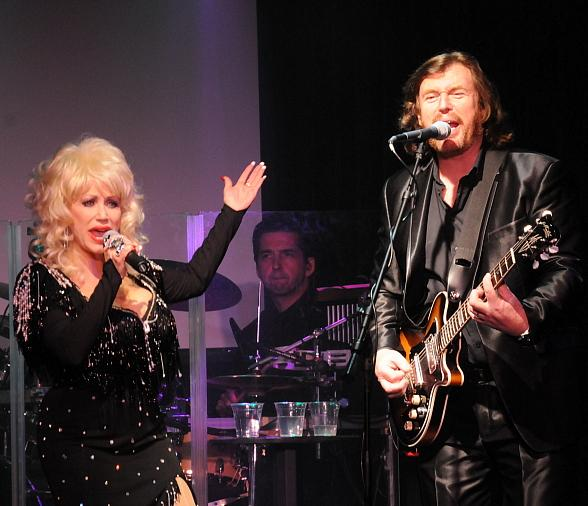 Sandy Van Anderson as Dolly Parton performs with Michael Clift as Barry Gibbs and Australian Bee Gees band